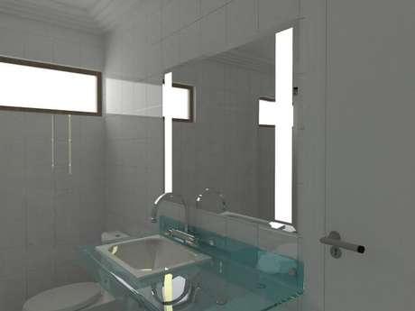 75. Lavabo com espelho com iluminação. Projeto de Fernando Lima