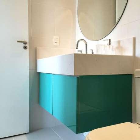 73. Lavabo com espelho para banheiro redondo. Projeto de Stephanie Esposito