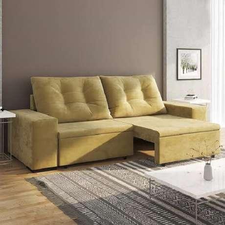 4. Modelo de sofá retrátil amarelo para sala de estar. Fonte: Pinterest