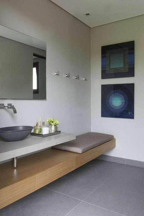 5. Cuba para banheiro de metal combina com um ambiente mais moderno. Projeto por Triplex Arquitetura