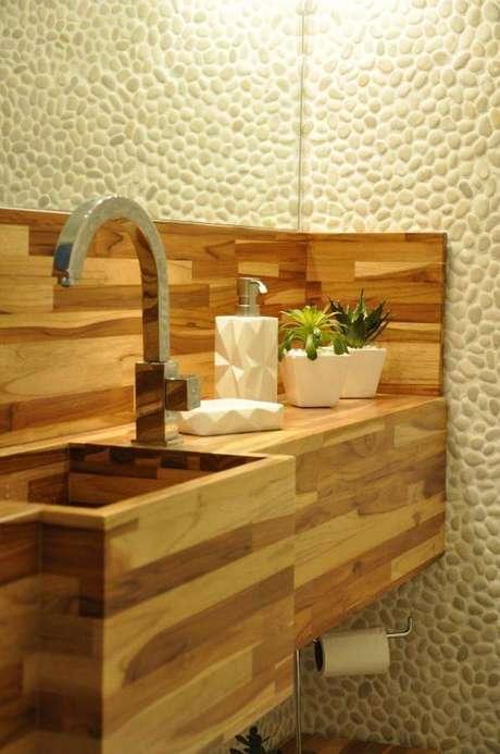 16. É importante verificar se o material da cuba para banheiro éresistente a água contínua, para não danificara peça. Projeto por Serra Vaz