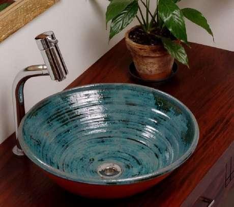33. A cubas para banheiro de cerâmica é idea ideais para ambientes rústicos. Fonte: Pinterest