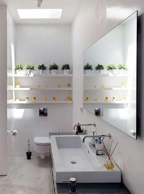 49. As cubas para banheiro em tamanho grande podem ter duas torneiras. Fonte: Pinterest
