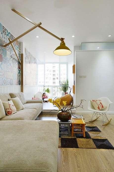 71. Sala de estar decorada com cadeira eames branca de balanço – Foto: ArchDaily