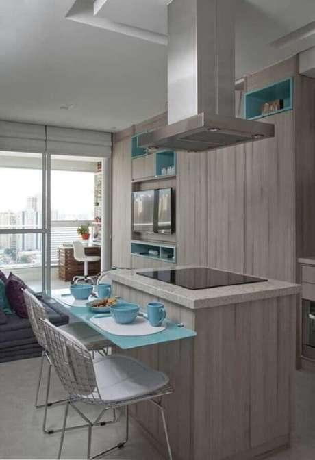 47. Ilha pequena para cozinha com cooktop integrada à sala de estar – Foto: Eduardo Cavalcanti Castro