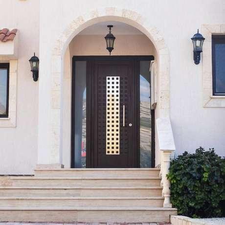 23. Modelo diferente de porta de ferro para entrada – Foto: Dcore Você