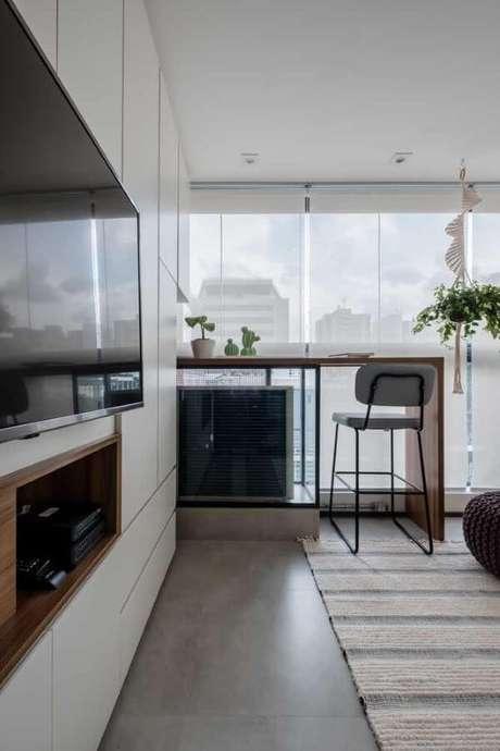 45. Sala de estar aconchegante com porcelanato acetinado – Via: Pinterest