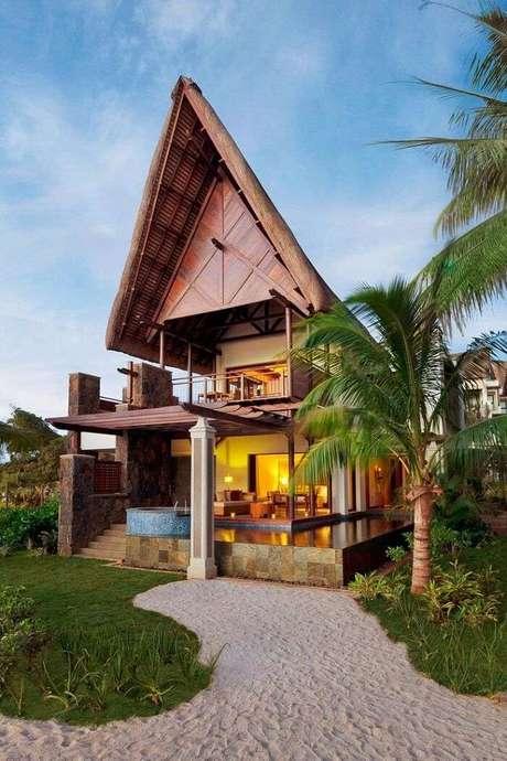 1. A madeira foi utilizada de forma elegante na construção dessa casa de praia. Fonte: Pinterest