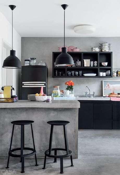 27. Cozinha preta decorada com bancada de cimento queimado – Foto: Futurist Architecture