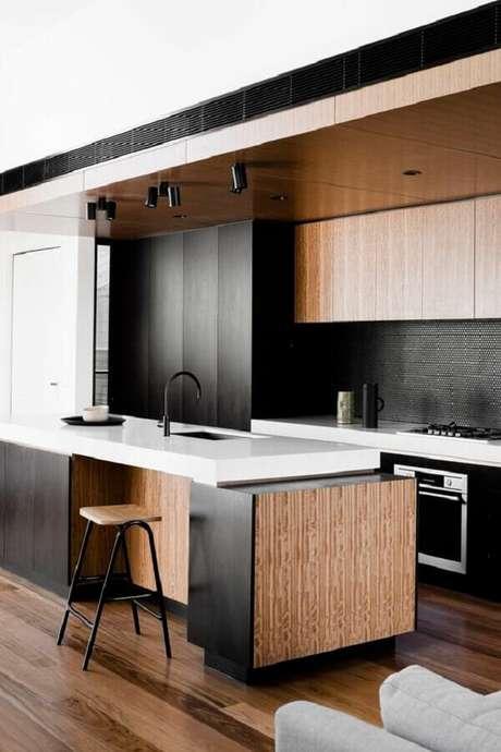 71. Marcenaria para decoração de cozinha planejada preta moderna – Foto: Decostore – Casa & Decoração