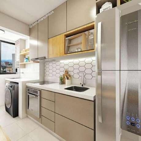 12. Decoração clean para cozinha planejada com lavanderia pequena – Foto: Pinterest