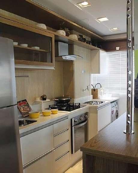 4. Invista em um projeto de cozinha com lavanderia que caiba em seu orçamento – Foto: Nosso Ape 406