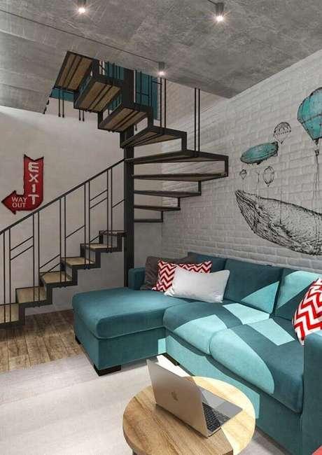 95. Sofá azul Tiffany para sala moderna com parede de tijolinho – Foto: Home Fashion Trend
