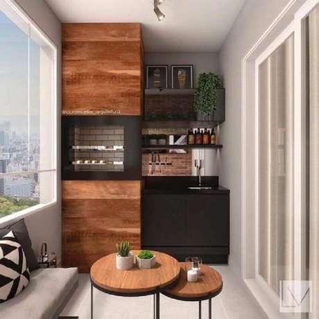14. Decoração de apartamento com área gourmet planejada com churrasqueira e armário preto – Foto: Deco Design