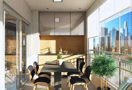 18. Área gourmet pequena e simples de apartamento com móveis planejados – Foto: Assetproject