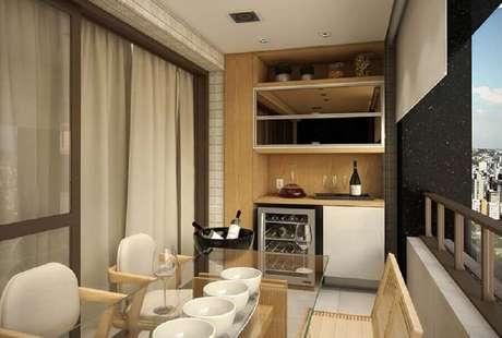 42. Decoração em cores neutras para área gourmet pequena de apartamento – Foto: Ideia Brasil