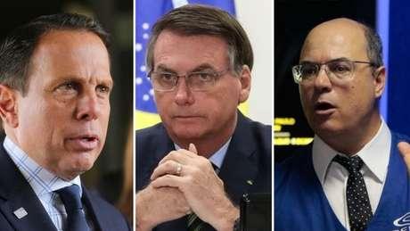 Bolsonaro (centro) criticou as restrições impostas pelos governadores João Doria (esq.) e Wilson Witzel