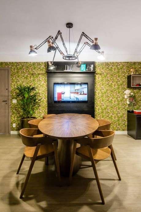 60. Escritório com painel para tv – Via: Arquitetura Perini