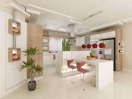 12. O pendente vermelho para cozinha ganha bastante destaque em um ambiente clean