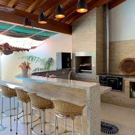 11. Área gourmet externa simples com churrasqueira planejada – Foto: Big Interior Design Blog