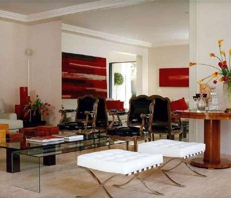 8. Quadro abstrato vermelho para decoração de casa sofisticada com ambientes integrados – Foto: Brunete Fraccaroli