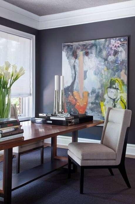 58. Sala de jantar moderna decorada com quadro abstrato grande colorido – Foto: Archidea