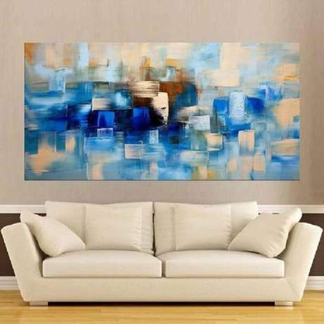 60. Sala decorada com quadro abstrato azul – Foto: Pinterest