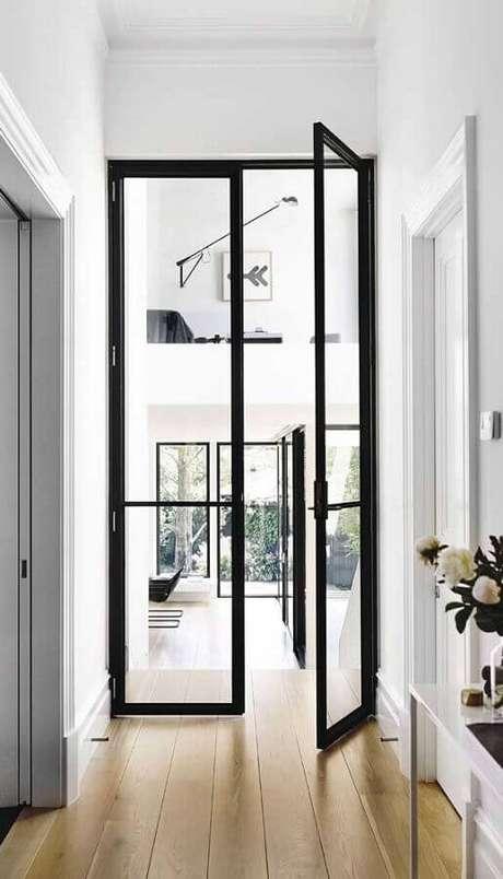 28. Decoração de casa clean com porta francesa de alumínio e vidro – Foto: Pinterest