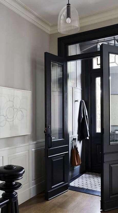 45. Porta francesa preta para entrada de prédio – Foto: Architecture Art Designs