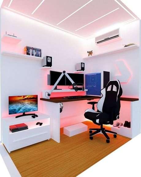 59. Decoração com led rosa para quarto gamer feminino todo branco – Foto: Futurist Architecture