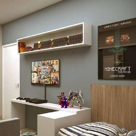 73. Quadro para decoração de quarto gamer – Foto: Peterson Brito Design