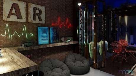 25. No projeto de Marcela Romão, o quarto gamer tem uma decoração bem moderna