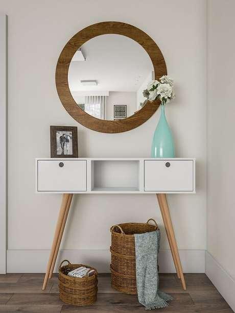 28. O aparador retrô traz delicadeza para o cômodo. Fonte: Pinterest
