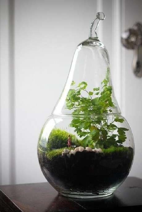 74. O terrário em forma de pera chama a atenção no ambiente. Fonte: Pinterest