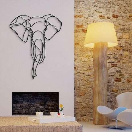 8. A escultura de parede feita em ferro forma a imagem de um elefante. Fonte: Pinterest