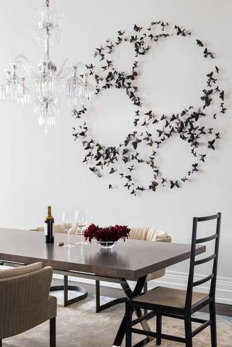 4. Escultura de parede metal feita com pequenas borboletas. Fonte: Pinterest