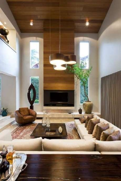 32. O sofá modular é perfeito para preencher ambientes amplos. Fonte: Pinterest