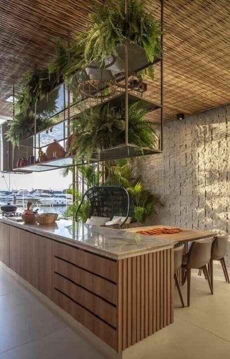 63. Varanda gourmet decorada com prateleira suspensa para plantas – Foto: Futurist Architecture