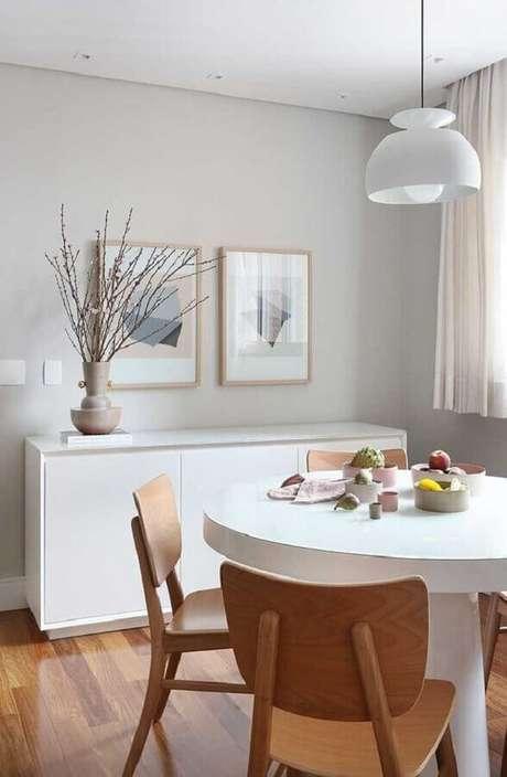 20. Decoração clean com quadro de parede para sala de jantar moderna – Foto: Casa de Valentina