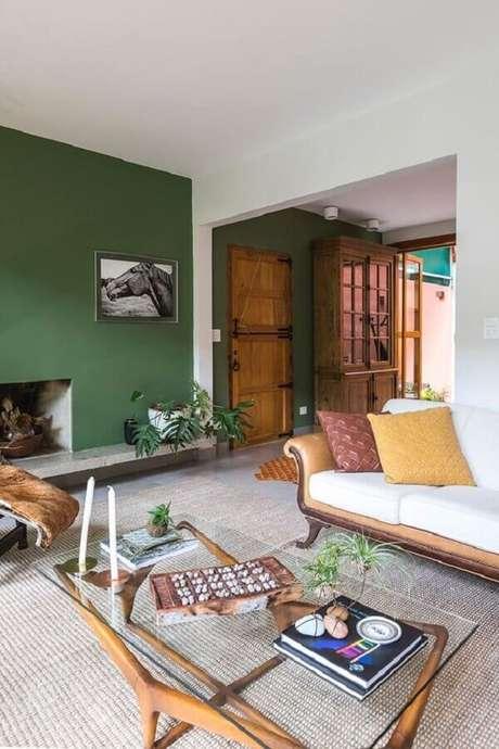 19. Invista em detalhes colorido para a decoração de sala verde – Foto: Casa de Valentina