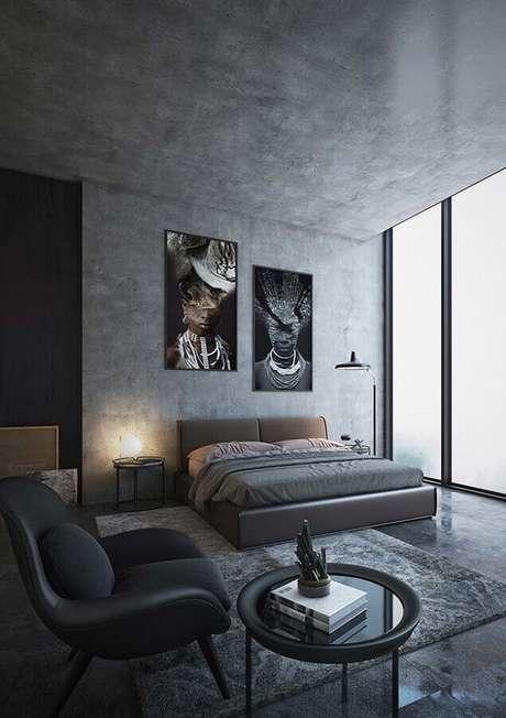 27. Decoração moderna com quadro de parede para quarto cinza com teto e parede de cimento queimado – Foto: Pinterest