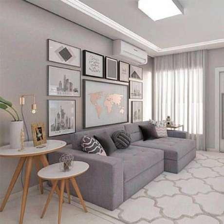 42. Quadro de parede para sala de estar cinza com estilo moderno – Foto: Pinterest