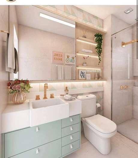 60. Tons pastéis para banheiro decorado com gabinete verde menta – Foto: Marilia Zimmermann