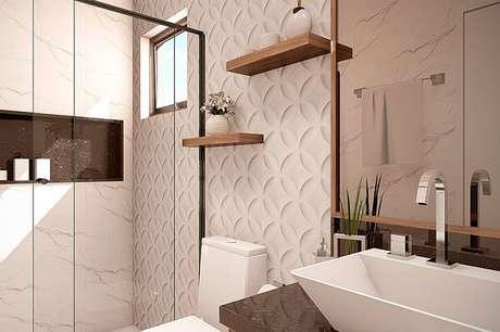 63. Traga estilo e personalidade incluindo revestimento 3D para banheiro. Fonte: Planta Pronta