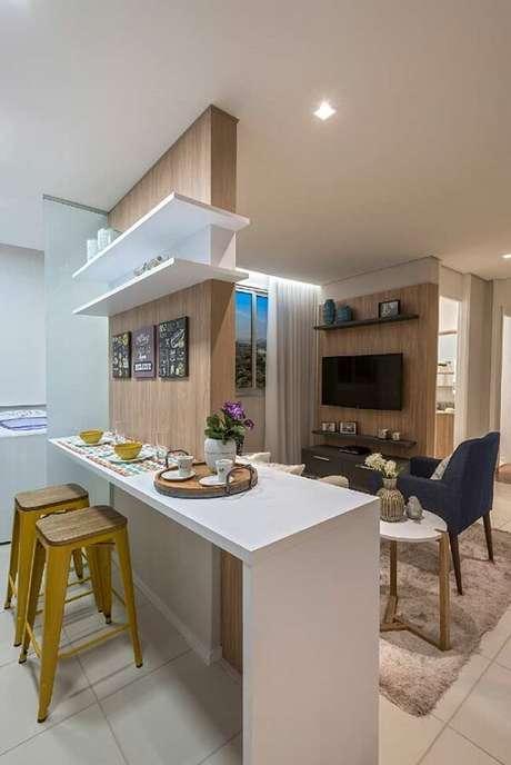 48. Kit quadros decorativos para cozinha fixados acima da bancada. Fonte: Pinterest