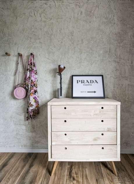 19- Na decoração moderna, a parede com efeito, marmorato realça o móvel. Fonte: Pinterest