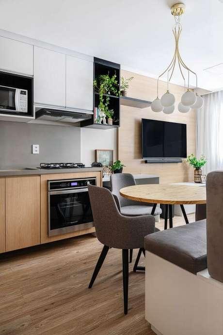 11. Cozinha com mesa pé palito redonda – Via: Rubiam Vieira Interiores