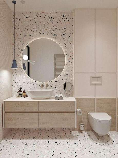 10. O espelho redondo para banheiro com iluminação embutida se destaca na decoração – Foto: Futurist Architecture