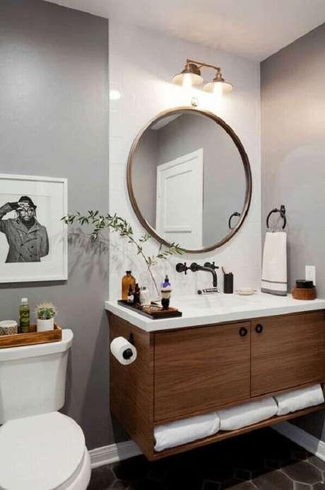 1. O espelho redondo para banheiro pode colocar um toque todo especial na sua decoração – Foto: Apartment Therapy