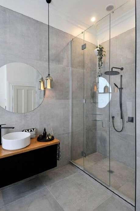 17. Banheiro cinza moderno decorado com espelho redondo para banheiro sem moldura – Foto: Futurist Architecture
